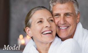 Mature Couples Faces Smiling and Embracing in Bath Robes