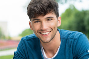 Young Smiling Male in Blue Shirt